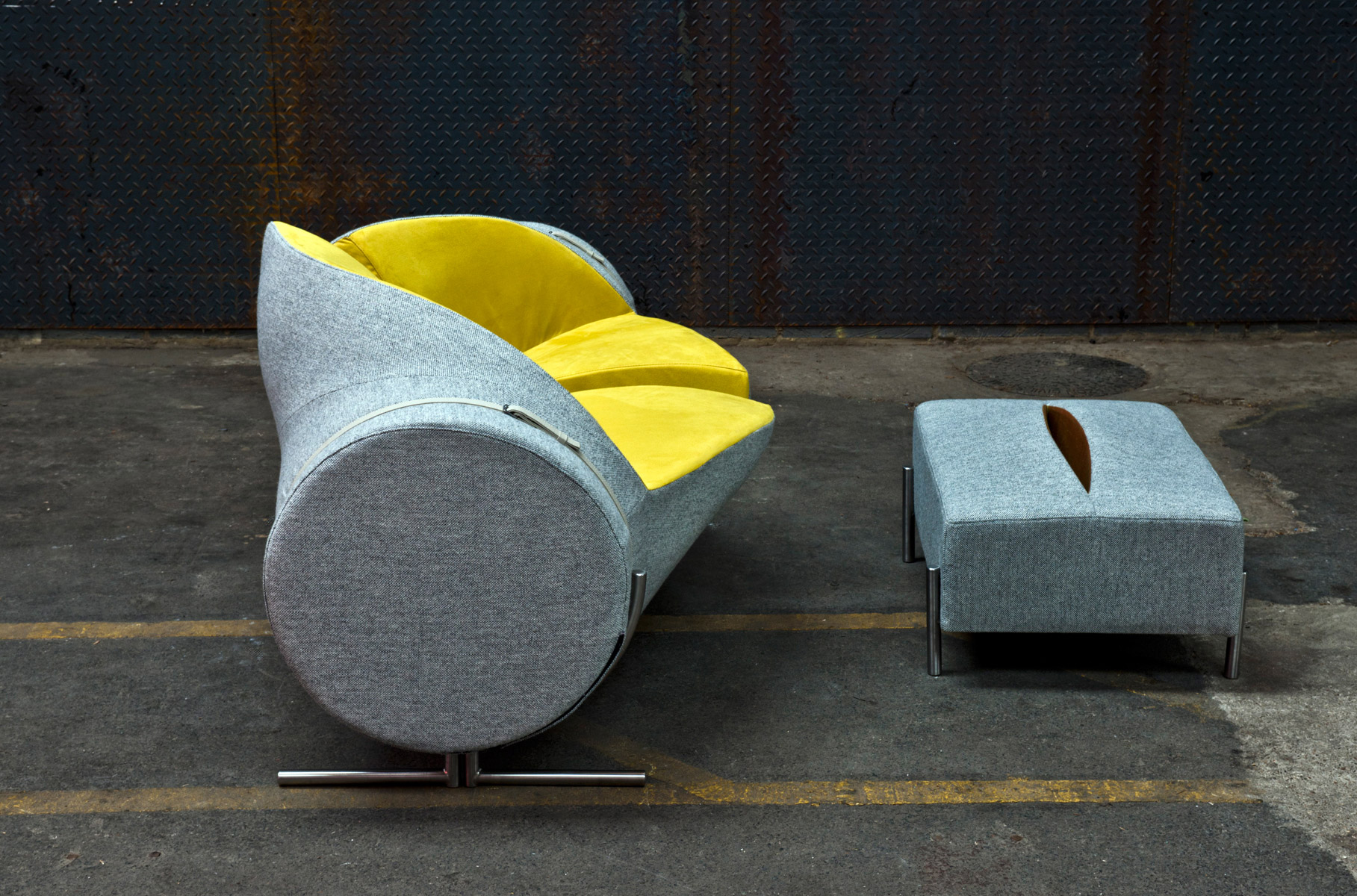 Slashed Sofa & Ottoman by Charlotte Kingsworth